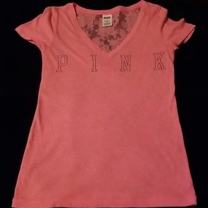 Pink shirt with black lettering and lace back